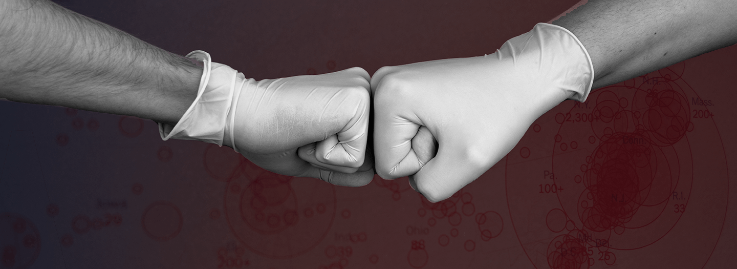 Image of two gloved hands fist bumping to promote article